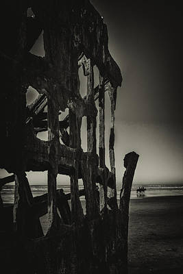 Photograph - The Shipwreck At Ft. Stevens State Park by Jean-Jacques Thebault