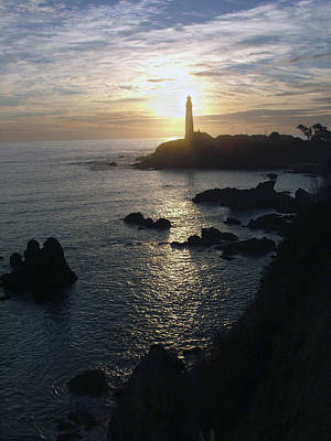 Ano Nuevo Photograph - The Sun Is Setting Behind The Pigeon Point Light Station Near Ano Nuevo by Scott Lenhart
