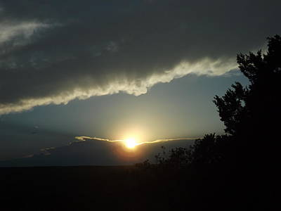 Photograph - The Sun Setting Behind The Storm by Rebecca Cearley