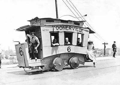 Medium Group Of People Photograph - The Toonerville Trolley by Underwood Archives