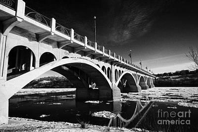 the university bridge over the freezing south saskatchewan river Saskatoon Canada Art Print by Joe Fox