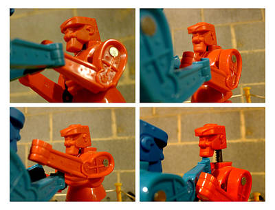 Rockem Sockem Robots Photograph - The Victor by Richard Reeve