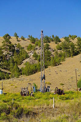 Birds Rights Managed Images - The Worlds Only Hand Dug Oil Well Royalty-Free Image by Jeff Swan