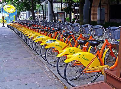 Thirty Yellow Bicycles In Taipei Art Print by Tony Crehan