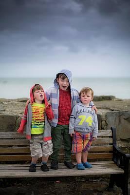 Three Boys On Bench Art Print by Samuel Ashfield