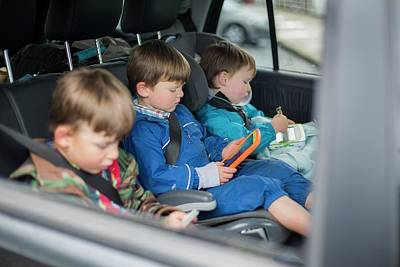 Candid Photograph - Three Brothers In Car With Digital Device by Samuel Ashfield