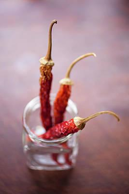 Jar Photograph - Three Dried Chilies In A Glass Jar by Tobias Titz