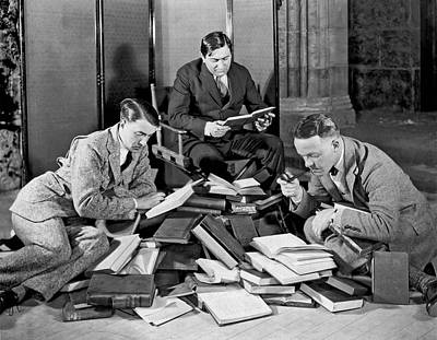 Photograph - Three Men Searching Books by Underwood Archives
