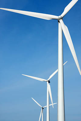 Three Mighty Windmills In A Row Against A Blue Sky. Art Print