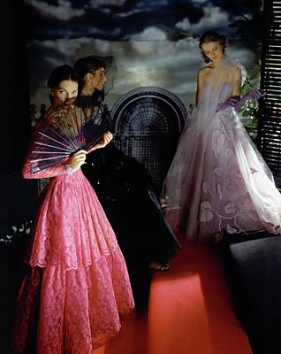 Ball Gown Photograph - Three Models Wearing Ball Gowns by Horst P. Horst