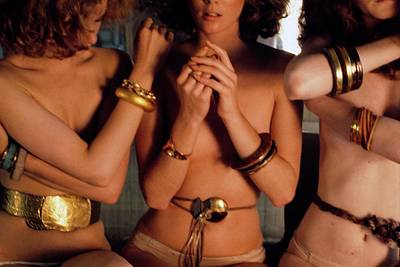 Gold Bracelet Photograph - Three Models Wearing Bangles And Belts by Deborah Turbeville