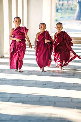 Three Novice Monks Walking - Myanmar Art Print by Matteo Colombo