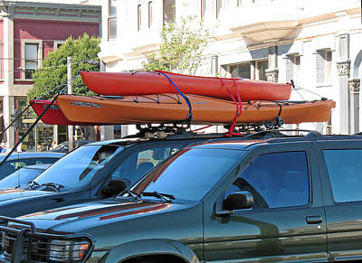 Photograph - Three Orange Kayaks by Connie Fox