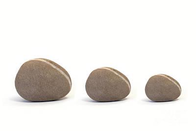 Three Pebbles Against White Background Art Print