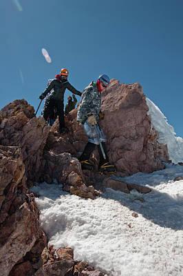 Mt Shasta Photograph - Three People Climb Down Rocks by Beth Wald