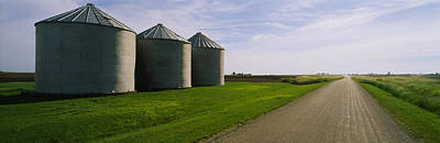 Three Silos In A Field Art Print by Panoramic Images