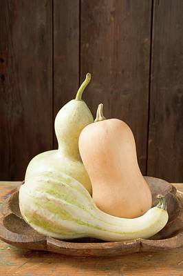 Three Squashes In Bowl In Front Of Wooden Wall Art Print