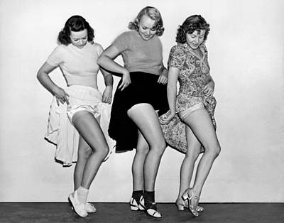 Photograph - Three Women Lift Their Skirts by Underwood Archives