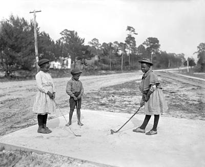 Black Children Photograph - Three Young Children Play Golf by Underwood Archives