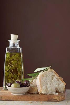 Thyme Oil In Bottle, Olives And White Bread On Chopping Board Art Print