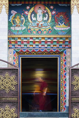 Tibetan Monk And The Prayer Wheel Art Print by Tim Gainey
