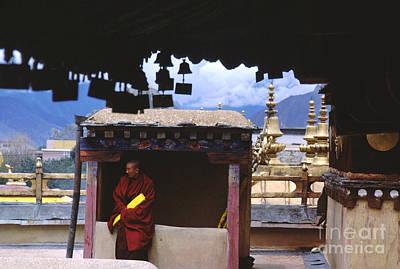 Tibetan Monk With Scroll On Jokhang Roof Art Print by Anna Lisa Yoder