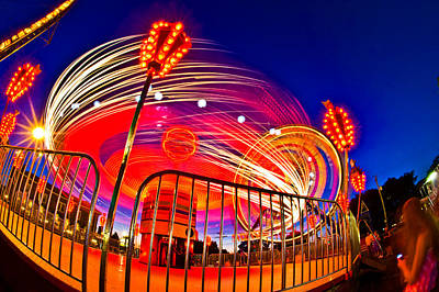 Enjoyment Photograph - Time Exposure Of A Carnival Ride by Panoramic Images
