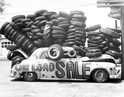 Antique Automobiles Photograph - Tire Sale by Retro Images Archive