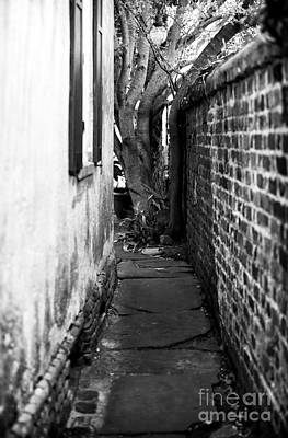 Charleston Photograph - To Pirates Courtyard by John Rizzuto