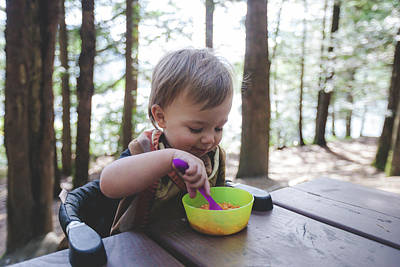 Harrison Hot Springs Wall Art - Photograph - Toddler Eating At Picnic Table While by Christopher Kimmel