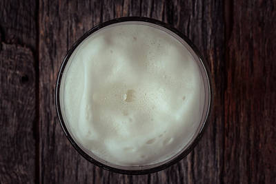 Beer Royalty-Free and Rights-Managed Images - Top View of Foam on a Pint of Beer by Brandon Bourdages