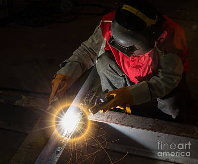Steel Fabrication Photograph - Top View Of Worker Work Hard With Welding Process by Anek Suwannaphoom
