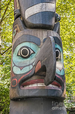 Photograph - Totem Pole In Seattle  by Bryan Mullennix