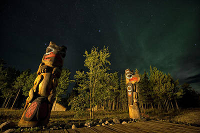 Totem Poles At Night. Tlingit Culture Art Print by Peter Mather