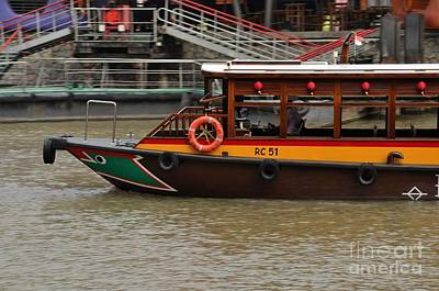 Photograph - Tourist Ferry Bumboat Vessel Cruising Singapore River by Imran Ahmed
