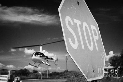 Stop Sign Photograph - Tourist Light Helicopter Landing Behind Stop Sign Kissimmee Florida Usa by Joe Fox