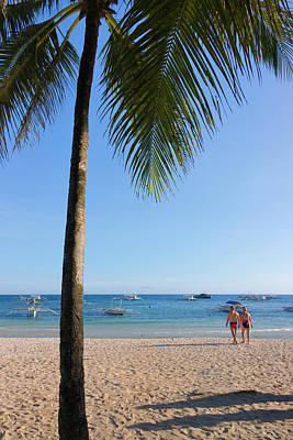 Filipino Photograph - Tourists And Palm Tree On The Beach by Keren Su