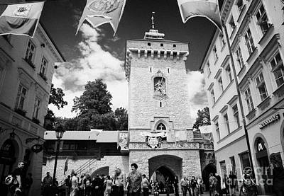 Cracovia Photograph - tourists and visitors at the Florianska Gate old city entrance to krakow by Joe Fox
