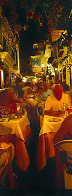 Tourists At A Sidewalk Cafe, Marbella Art Print by Panoramic Images