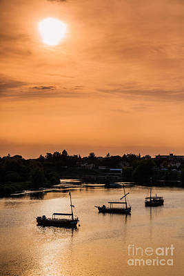 Photograph - Tourists Boats Moored On The Dordogne At Bergerac At Dusk. by Peter Noyce