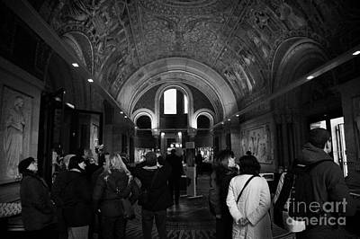 Kudamm Photograph - tourists inside the Gedenkhalle memorial hall of Kaiser Wilhelm Gednachtniskirche by Joe Fox