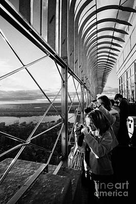 Tourists  Look At The View And Take Photos From Observation Deck Empire State Building Print by Joe Fox