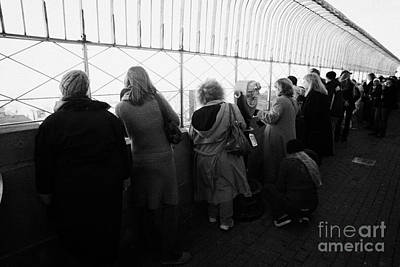 Manhaten Photograph - Tourists  Look At The View From Observation Deck Empire State Building by Joe Fox