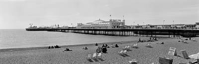 Tourists On The Beach, Brighton, England Art Print by Panoramic Images