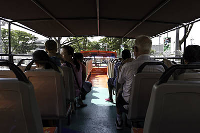 Tourists On The Sight-seeing Bus Run By The Hippo Company In Singapore Art Print by Ashish Agarwal