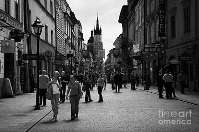 Tourists On The Ulica Florianska Street Leading Down From City Gates To Old Town City Centre Krakow Art Print by Joe Fox