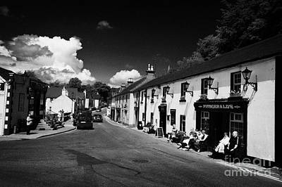 Avoca Photograph - Tourists Outside Fitzgeralds Pub And Main Road In The Village Of Avoca From The Tv Series Ballykissangel by Joe Fox