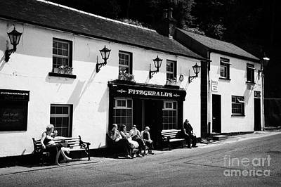 Tourists Outside Fitzgeralds Pub In The Village Of Avoca From The Tv Series Ballykissangel Art Print by Joe Fox