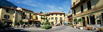 Outdoor Cafes Photograph - Tourists Sitting At An Outdoor Cafe by Panoramic Images