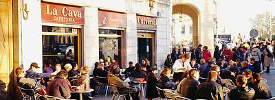 Barcelona Chair Photograph - Tourists Sitting Outside Of A Cafe by Panoramic Images